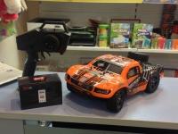 Радиоуправляемый шорт-корс Remo Hobby RH1621 4WD RTR масштаб 1:16 2.4G оранжевый
