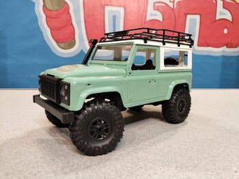 Радиоуправляемый краулер Land Rover Defender 90 1/12 4WD 2.4G зеленый