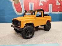 Радиоуправляемый краулер Land Rover Defender 91 pickup 1/12 4WD 2.4G желтый